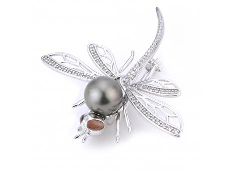 Pins make any outfit look refined and our dragonfly brooch in pearls and white topaz is completely disarming.  Head to R. Gregory Jewelers for the last units!